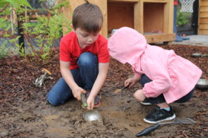 Children playing outside in Innovative's outdoor playscape