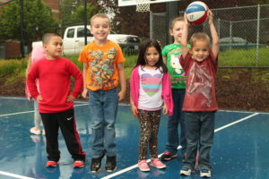 Children playing in our new outdoor sports court