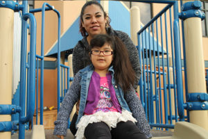 Photo of Sarah and her mom, on the playground in our Early Learning Facility