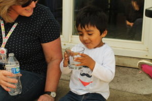 Photo of Gabriel drinking water at an Early Intervention Appointment